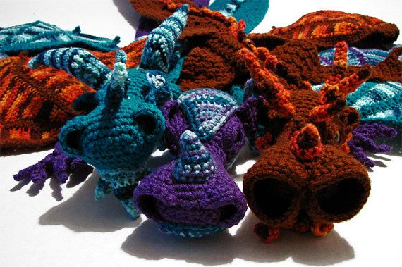 Dragon Scarf Crochet Pattern by MyntKat on Etsy ...approx $14AUD download PDF. May need to upskill before attempting this one!