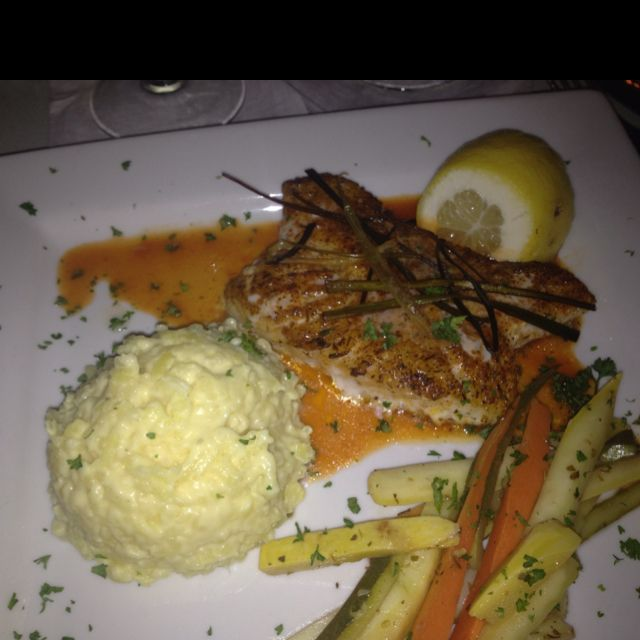 Sea bass in a reduction with julienne vegetables and ...