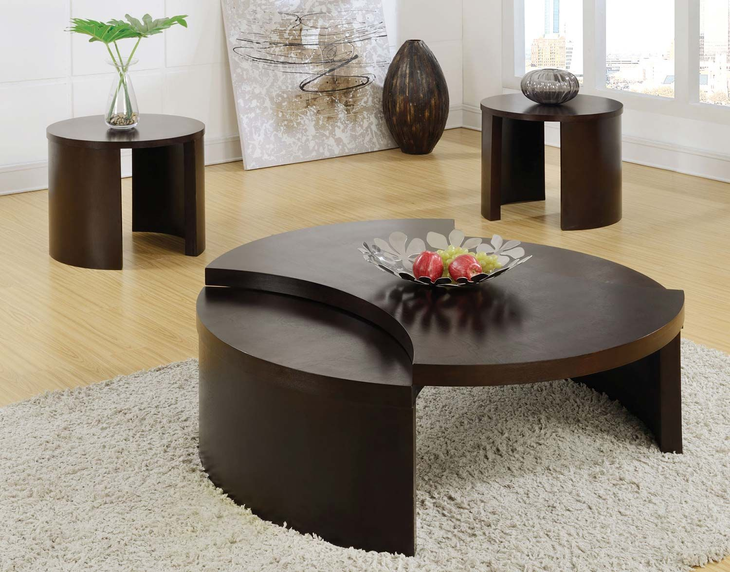 Coaster 70273 Occasional Set - Cappuccino - Unique bow-tie shaped Coffee table in a cappuccino Finish has a swivel feature to reveal storage space underneath. Pair with a complementary round End table.