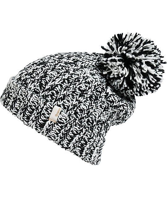 2db7d7bc This cuffed style beanie is made with a mixed black and white marled knit  construction finished with a large pom at the top and a logo tag on the  cuff.