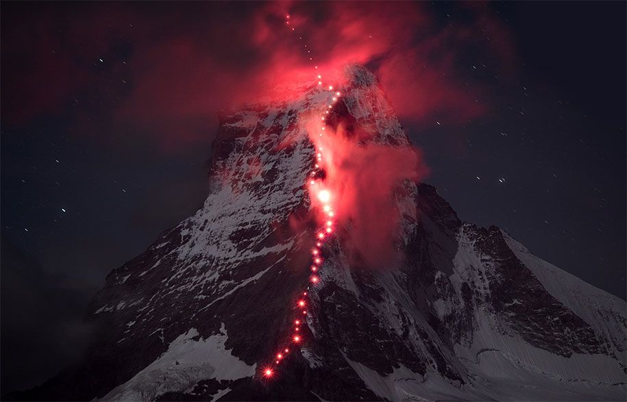 Swiss mountaineering brand Mammut collaborated with hundreds of fearless mountaineers and professional photographer Robert Bösch to create a majestic photoshoot in the Swiss Alps.