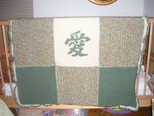 Love in Chinese character, cross-stitched onto single crochet by Danahibs