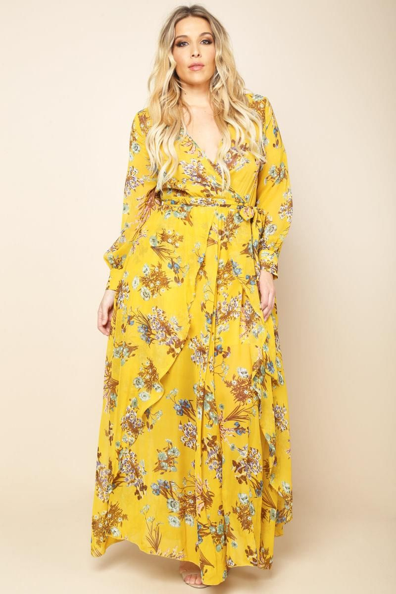 A plus size maxi dress with a wrapped V-neckline and long sleeves. Features  a belted waistline and an open front overlay. Floral print all over. 384819377
