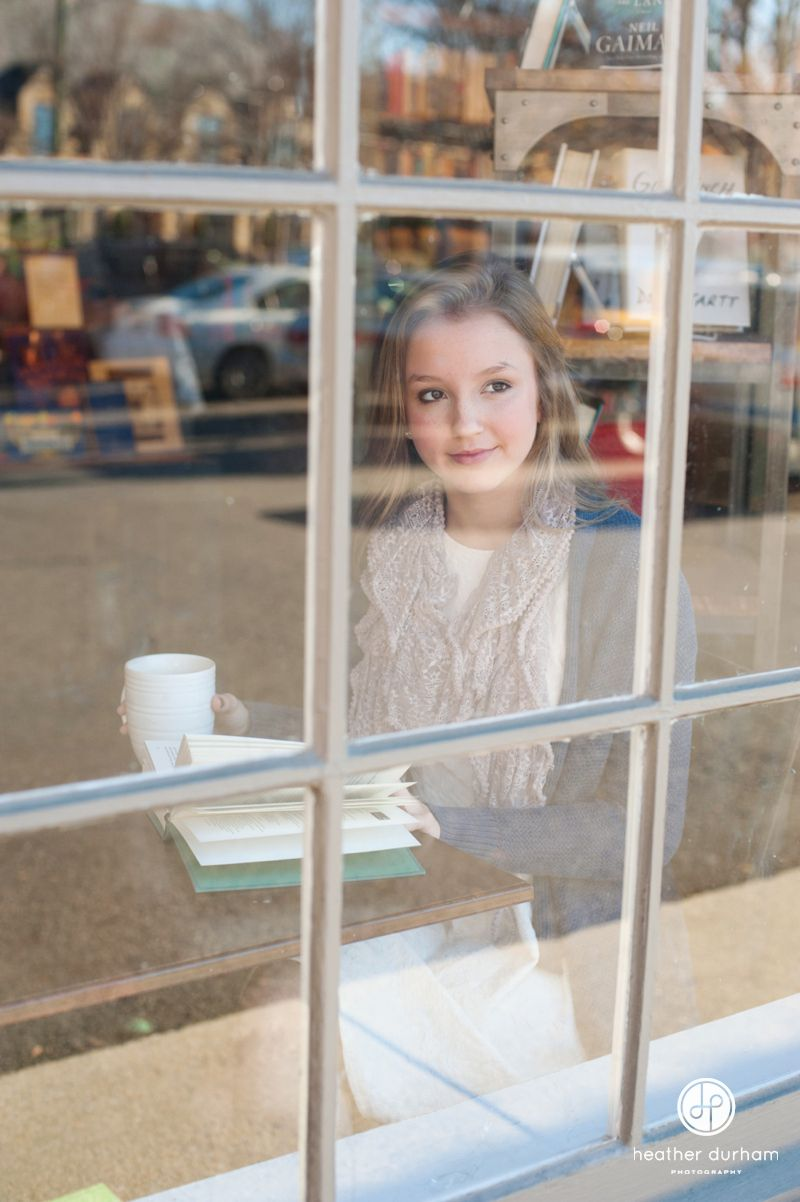 Senior portrait session in a coffee shop. Photo of highs
