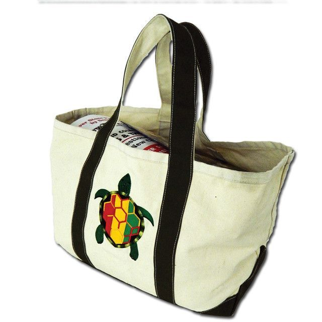 OK, we admit to an oversight here; hippies don't usually use WASPy Martha's Vineyard style canvas beach bags, but we made one anyway, in durable natural sail canvas, with our Rasta Terrapin embroidere