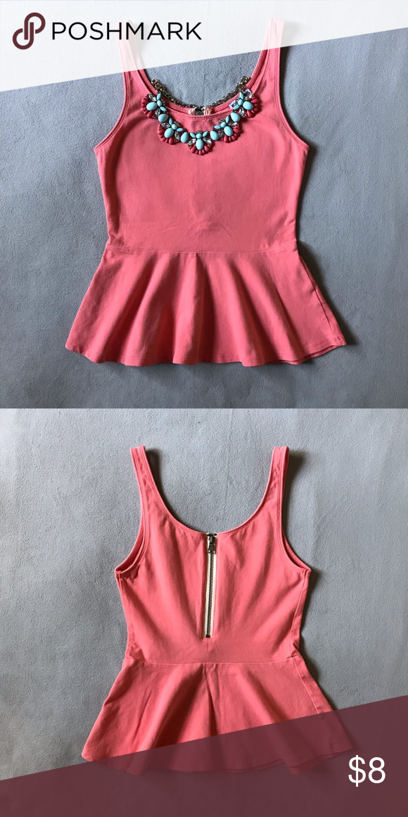 970b5d5be6710 Coral peplum top Peplum tank with zipper in the back. This shirt is very  comfy