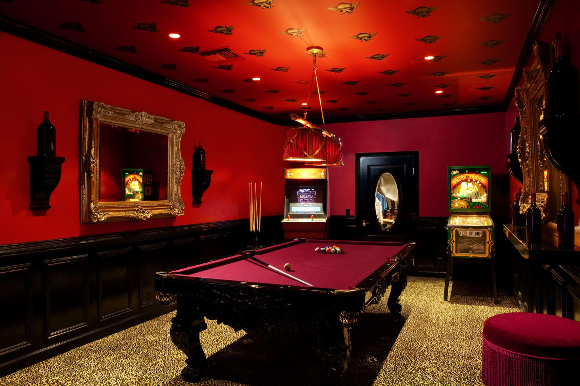 Divine home billiard room design with maroon billiard for Black and red room decor ideas