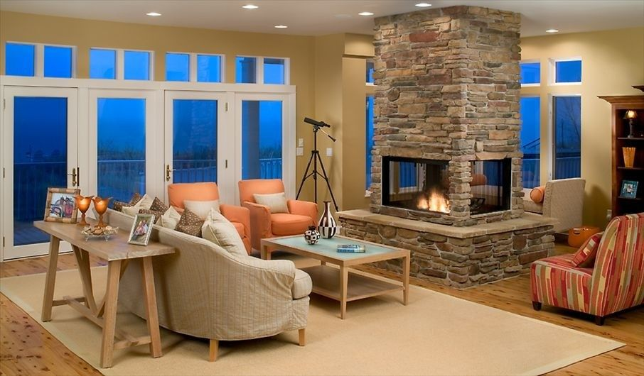 4 sided see through fireplace with stone surround for Four sided fireplace