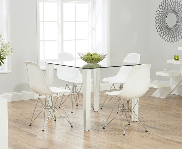 Shop The Madison Clear Glass Dining Table With Charles Eames Style DSR Eiffel Chairs At Oak Furniture Superstore Quick Delivery APR Available