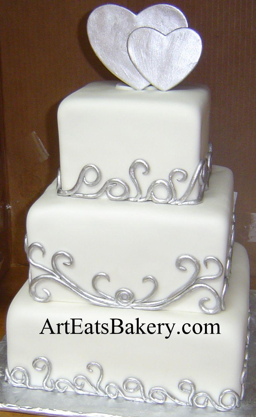 Three tier unique custom white wedding cake design with silver ...