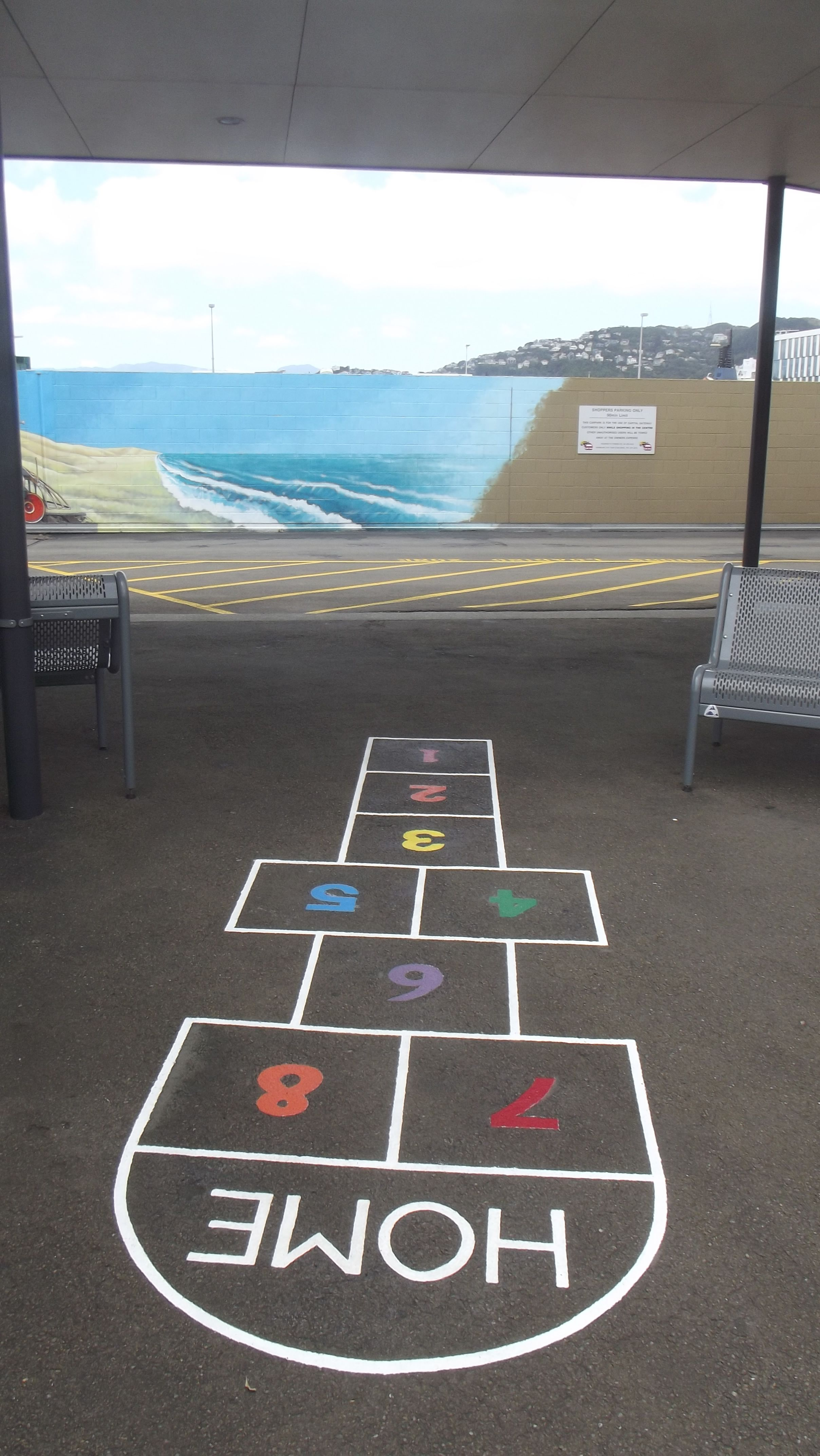 """Hop Scotch painted on foot path, upstairs, """"Capital Gateway Centre"""", Thorndon Quay, Wellington."""