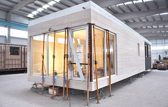 Casas cube sta es nuestra f brica de hogares casas for Casas prefabricadas galicia