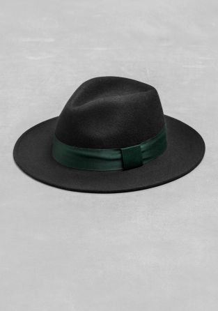 A wool hat with a wide brim and a simple, dark green ribbon.