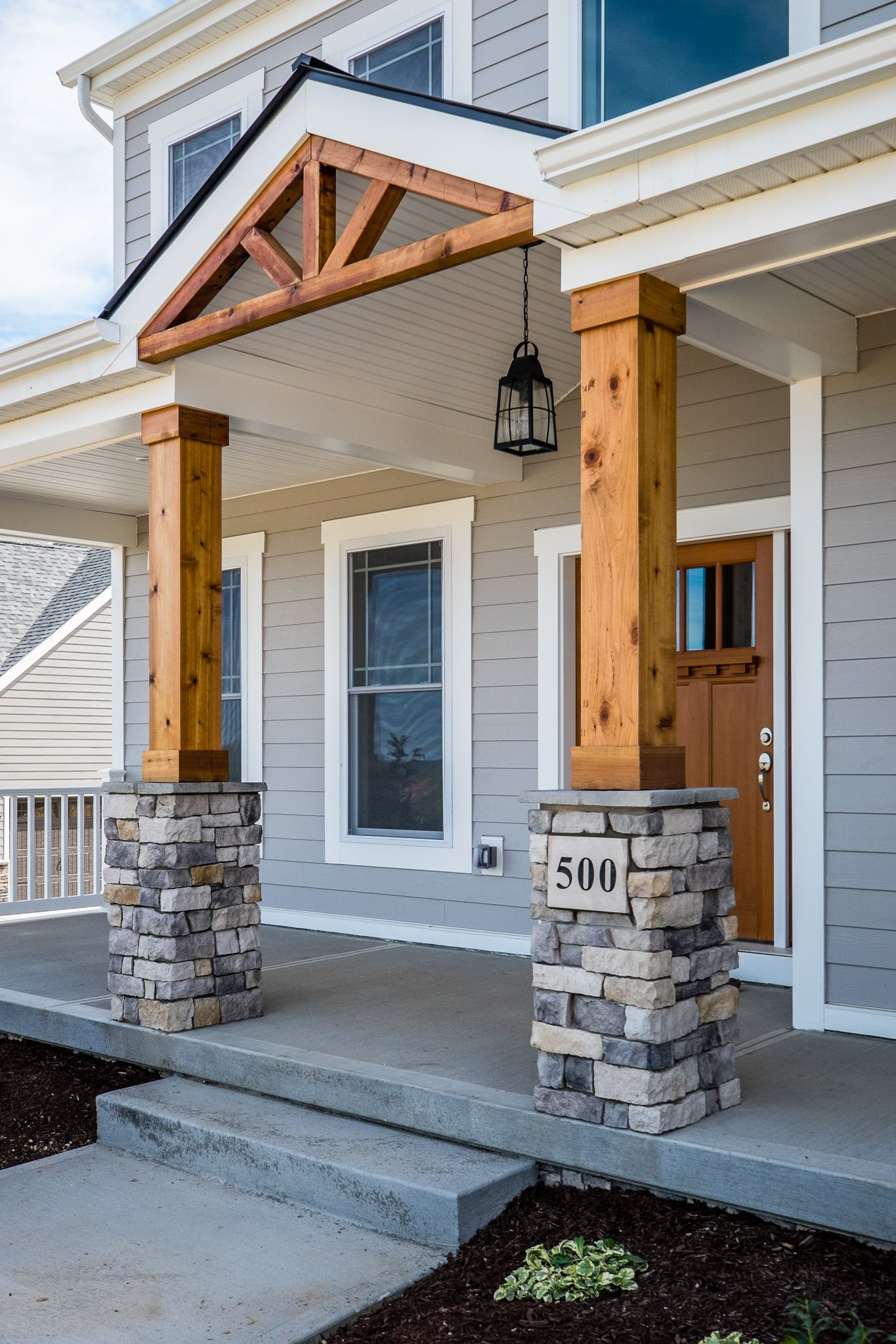 Gorgeous Front Porch! Wood and Stone Columns! | Home Exteriors in 2019 | Farmhouse front porches ...