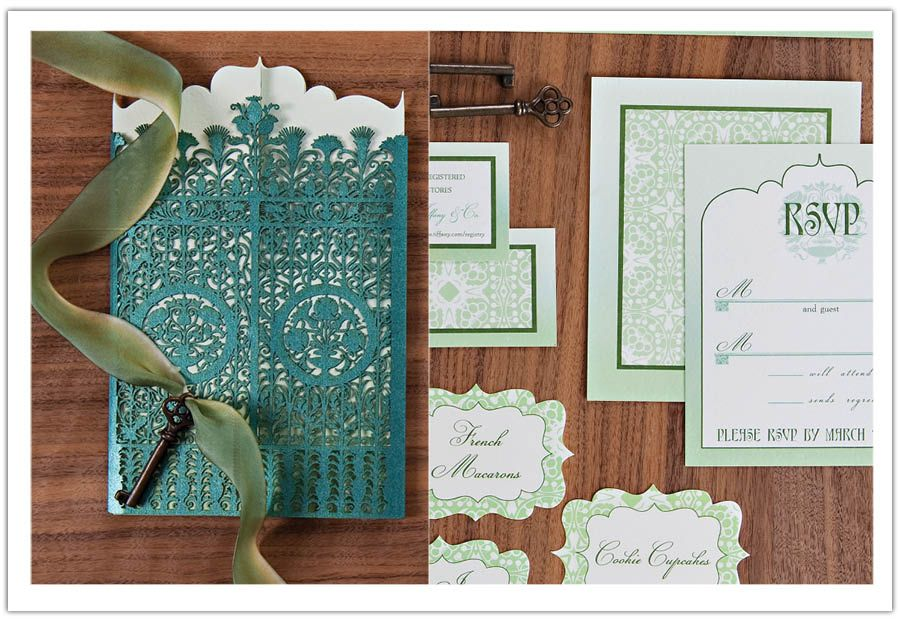 This intricate laser cut sleeve embellished with a key truly made this Secret Garden wedding invitation AMAZING. By Alchemy Fine Events www.alchemyfineevents.com