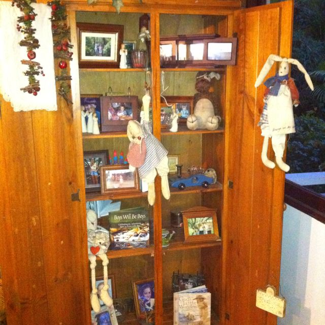 My favorite possession- a memory cupboard filled with my children's favorite toys & books from their childhood, photos I treasure, memories of places we've lived and friends we love!