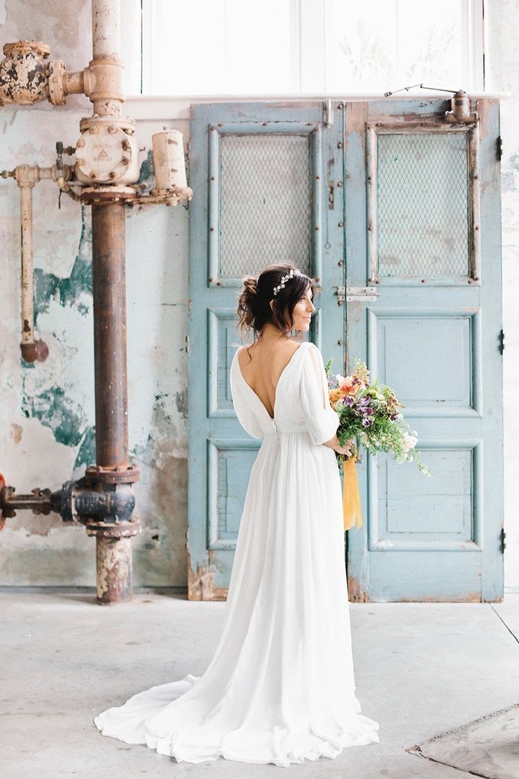 Draped, free flowing wedding dress: www.stylemepretty...