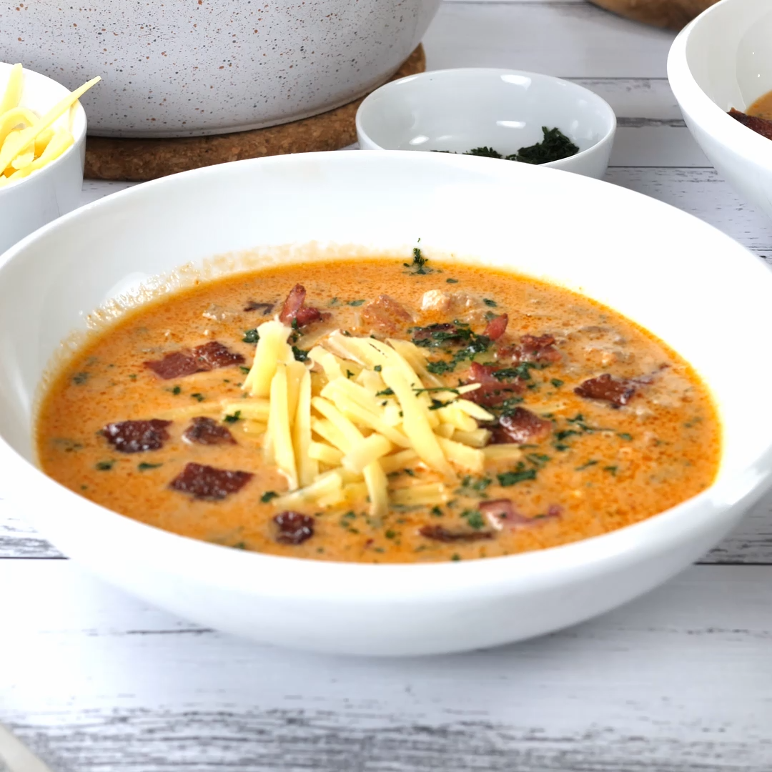 Keto Bacon Cheeseburger Soup #baconcheeseburgerdip Our Keto Bacon Cheeseburger Soup is the perfect meal when your craving burgers but want the comfort of soup. It's an easy, budget friendly dish that the whole family will love. This low carb beef soup is gluten free, healthy and very delicious. #keto #ketodiet #myketokitchen #soup #healthy