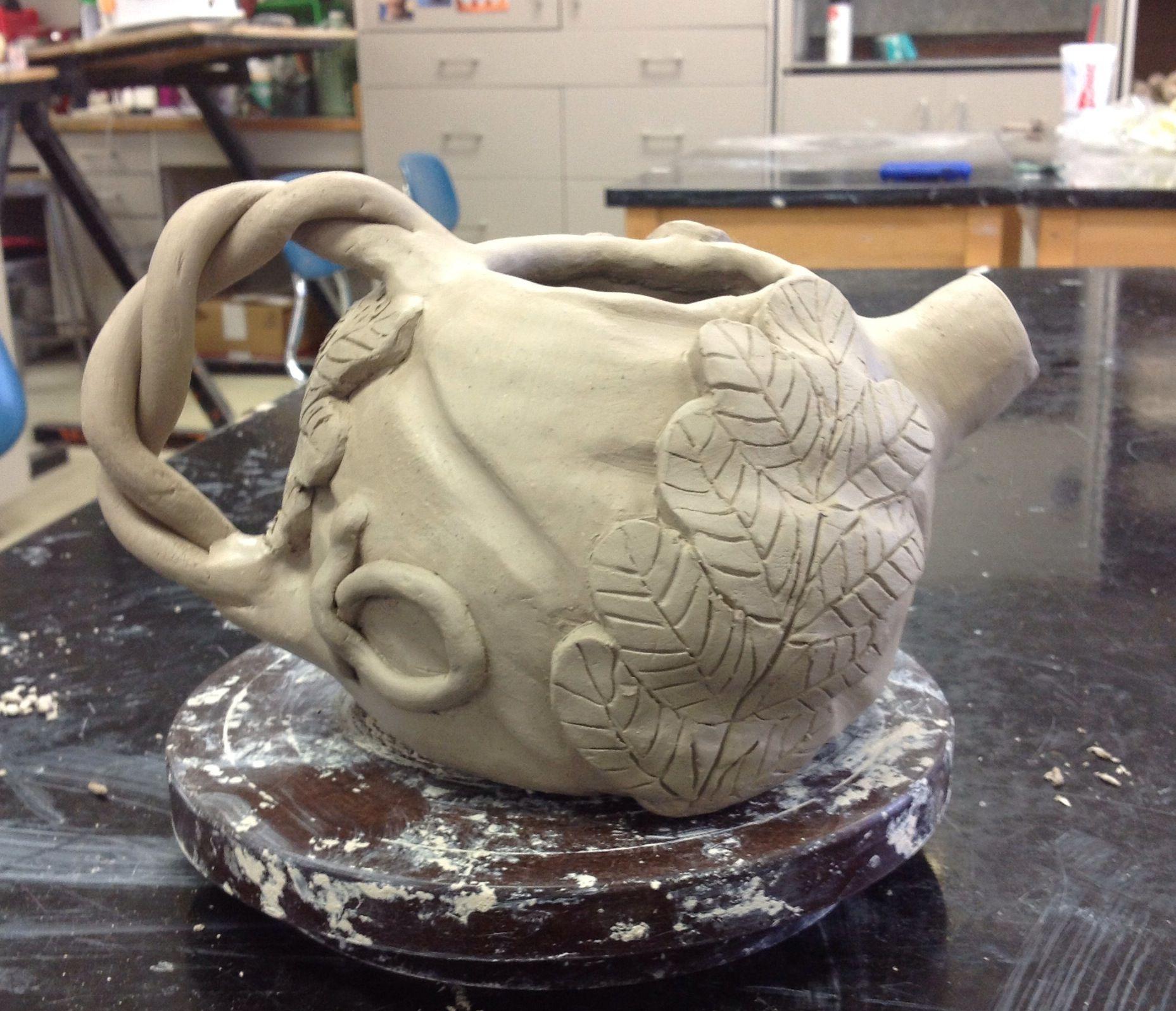 High school ceramics class hand built tea pot still in
