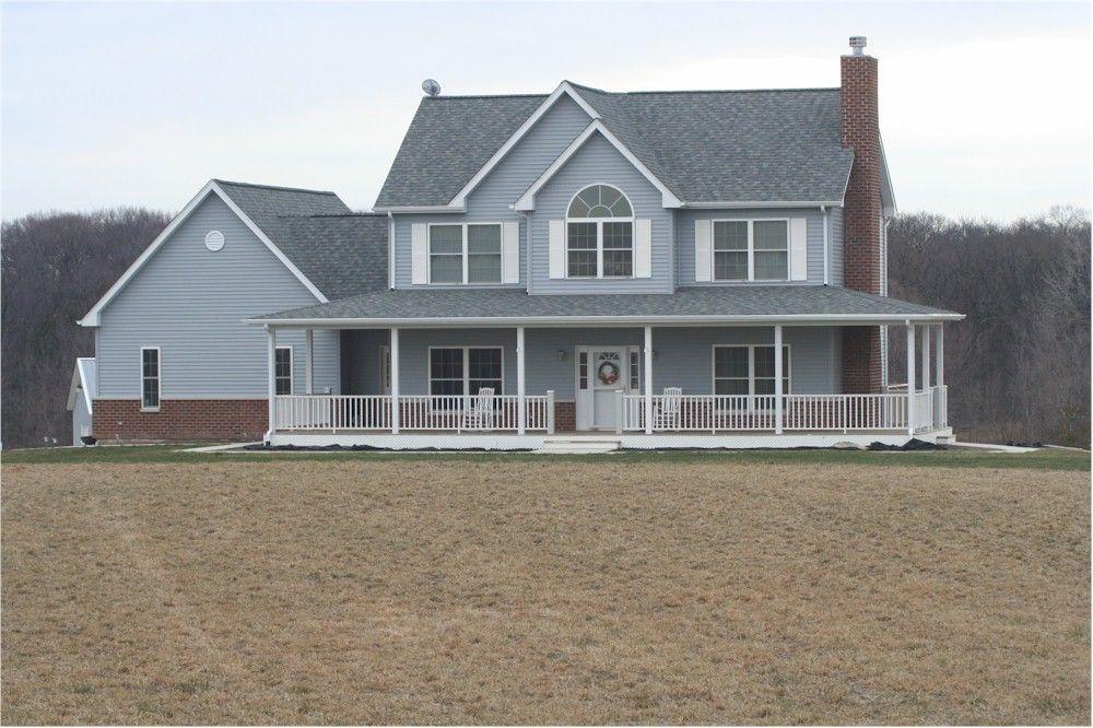 Hmmm... bottom half is brick; wrap around porch | Home ...
