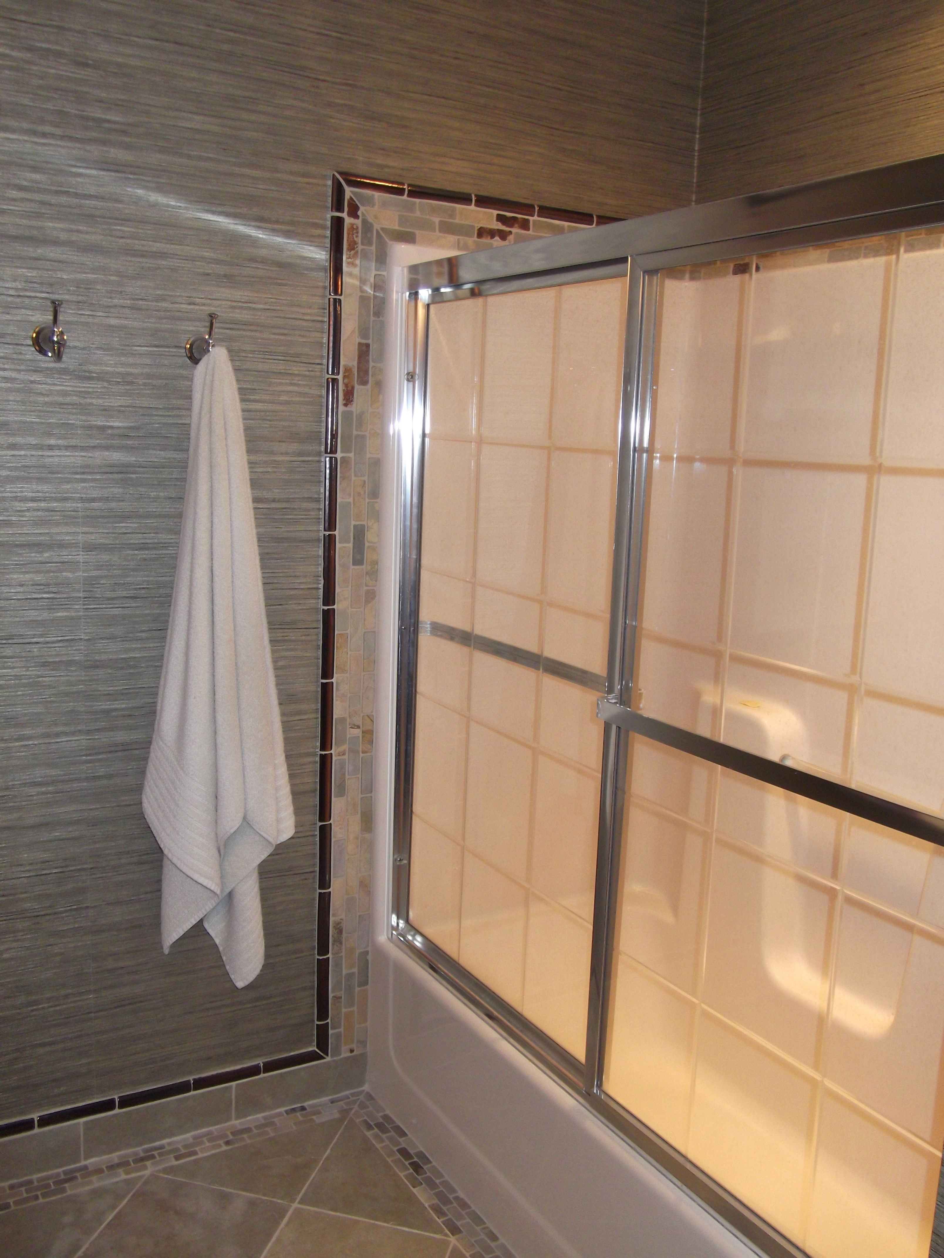 tile surrounding tub/shower inset; vinyl grasscloth