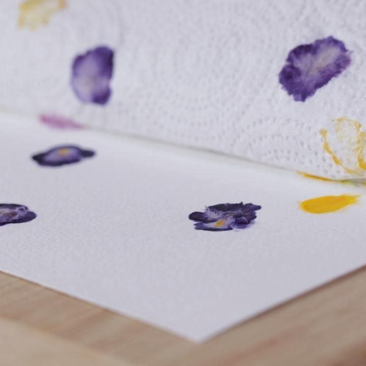 This easy pounding technique makes it so easy to transfer bright flower blooms onto paper. We love this technique to create the perfect Mother's Day present with supplies you already have at home. Learn how to make this easy pounded flower art. #poundedflowerart #preserveflowers #mothersday #diy #craftideas #bhg