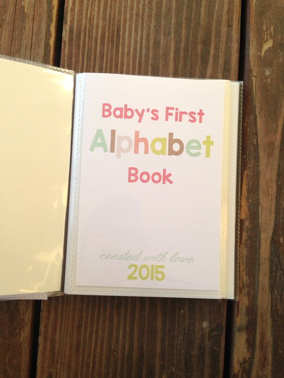 Diy alphabet book baby shower activity game baby book do it cute idea kind of expensive 3500 but could think of just getting are own cardstock and binding it for her diy alphabet book baby shower activity solutioingenieria