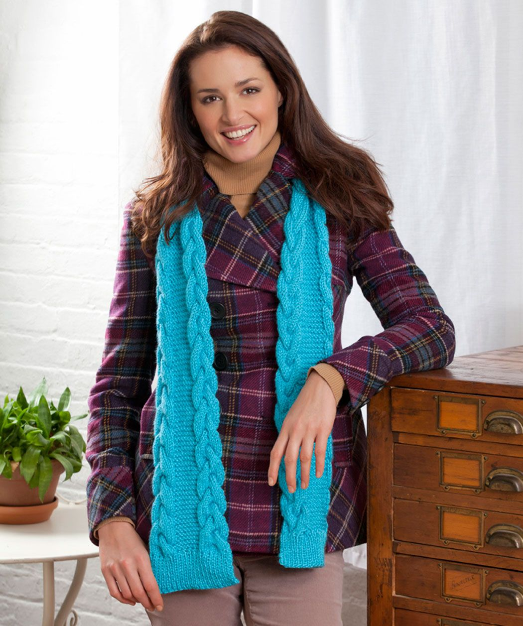 There's an interesting edge to this cozy scarf. Knit with braided cables and rib in between, this soft easy-care yarn is just the thing for warmth that feels good!