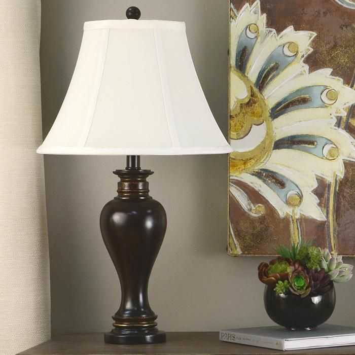Decor therapy walnut ridge table lamp designed to look like hand carved walnut wood the decor therapy walnut ridge table lamp brings rich brown tones to