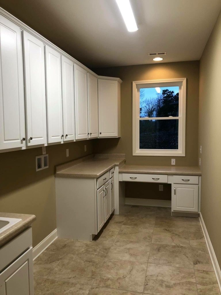 Angela Raines Worked With The Customer On This New Construction Home Providing Aristokraft Bartlett White In Laundry Wilsonart Natur Home Wilsonart Home Decor