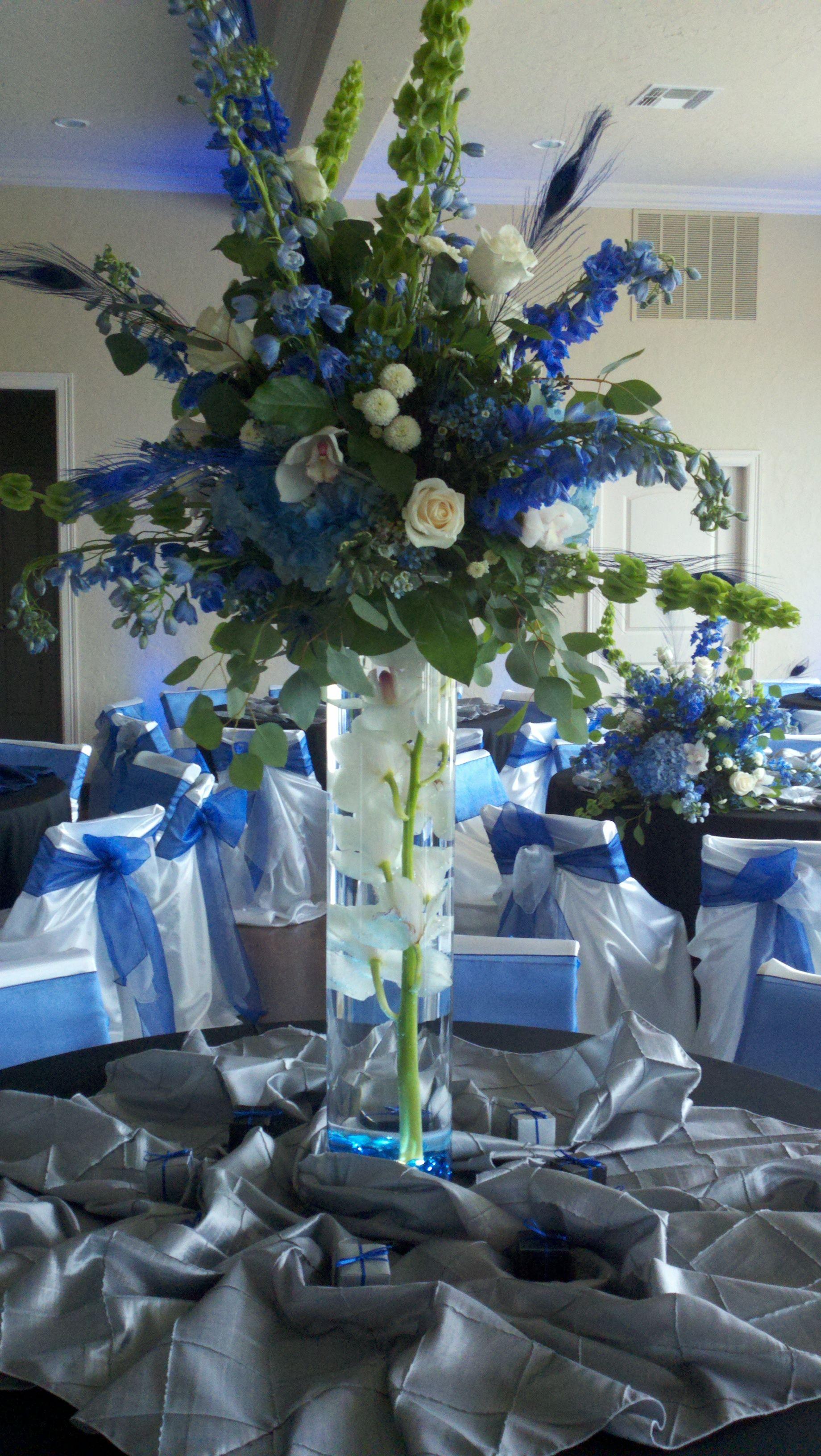 Large Centerpiece Blue Delphinium Bells Of Ireland Ivory Roses Blue Wedding Centerpieces Blue Flower Arrangements Wedding Arrangements