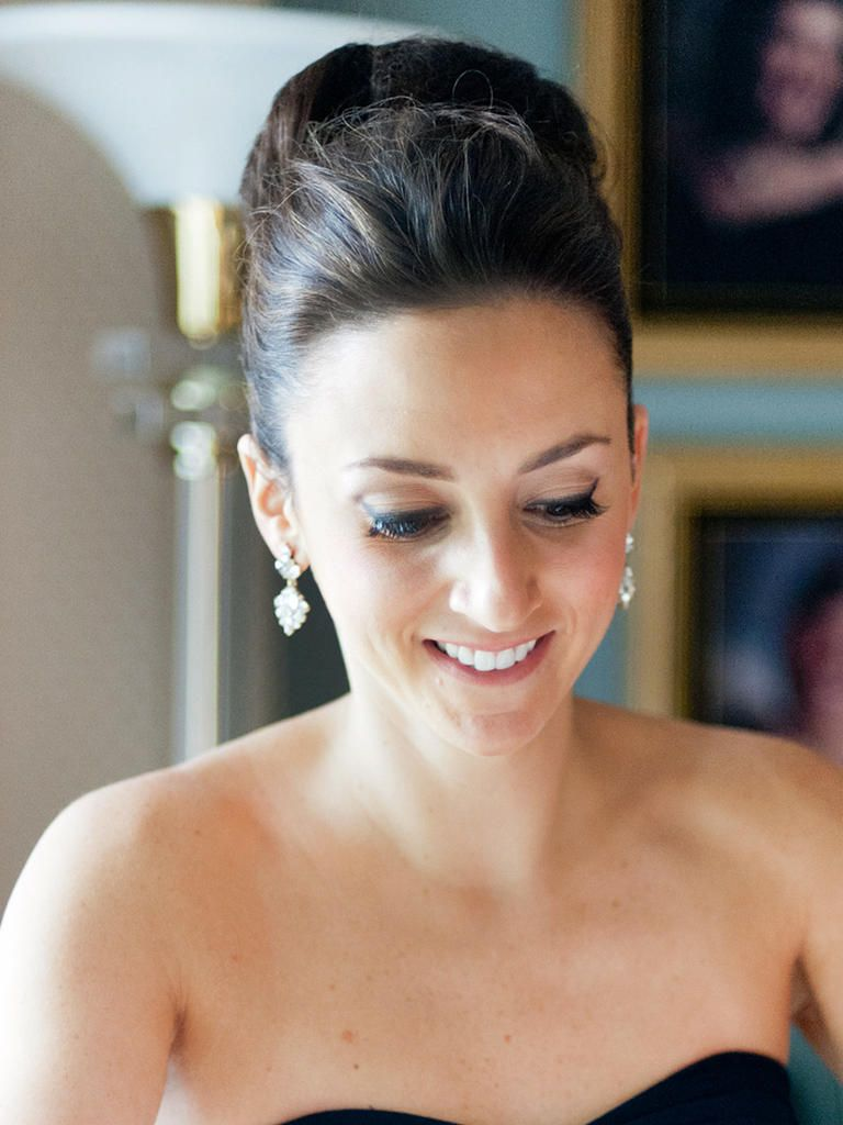 Showcase a strapless bridesmaid dress with a tight and chic top knot that is the perfect hairstyle for any glam wedding.