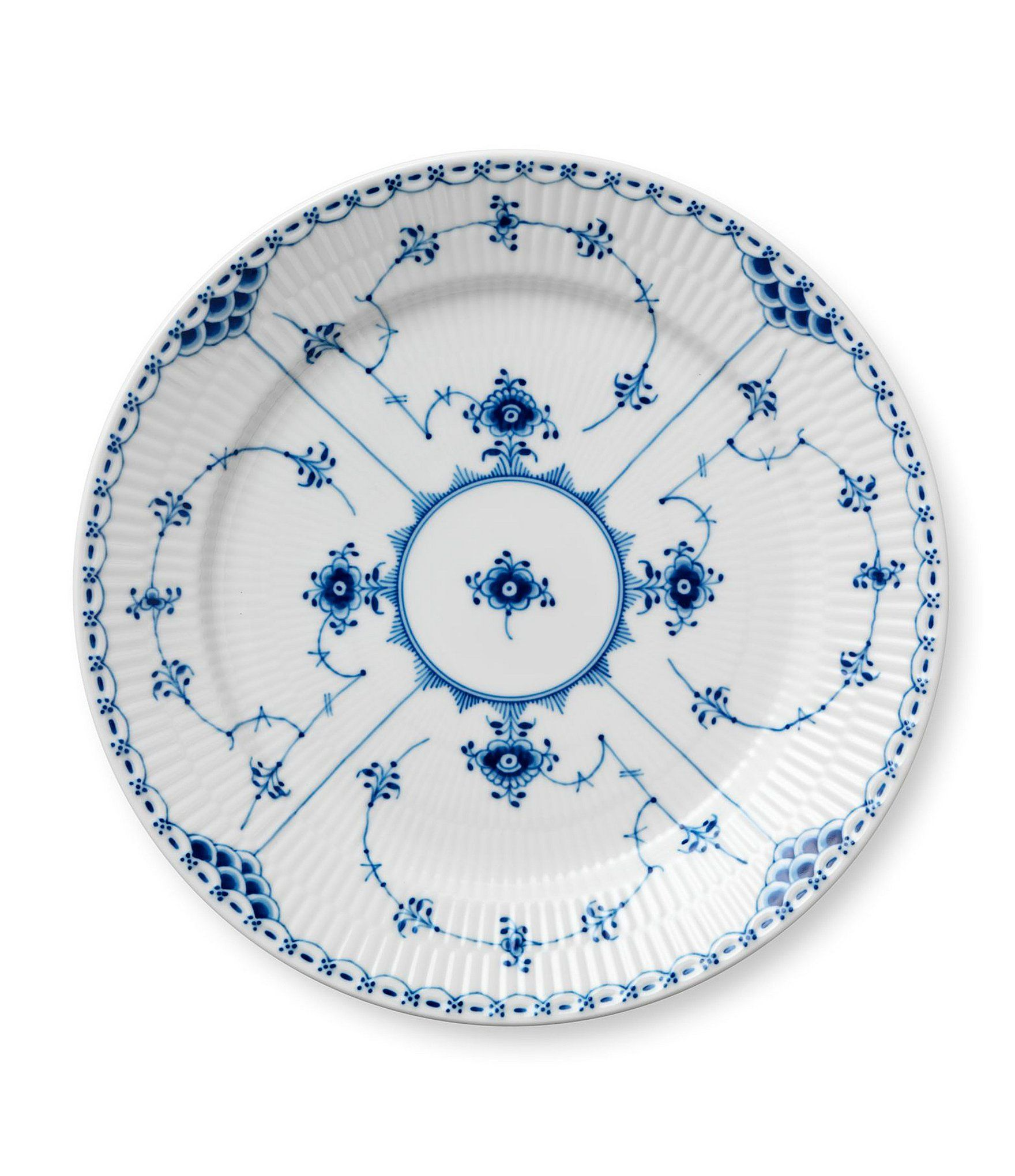 From Royal Copenhagen, this dinner plate features:Blue Fluted Half Lace is framed by its delicate lace trim, which acts as a foil for the hand-painted motif and charming snail shell on each lid. A versatile classic. It takes 1,1997 brush strokes- no more, no less - to paint a Blue Fluted Half Lace Dinner Plate. Meticulous work and gorgeous art always went  hand in hand.  Porcelain Blue Fluted Half Lace Collection Han