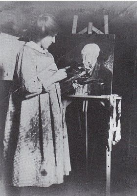 Artist Dora Carrington in a painting smock