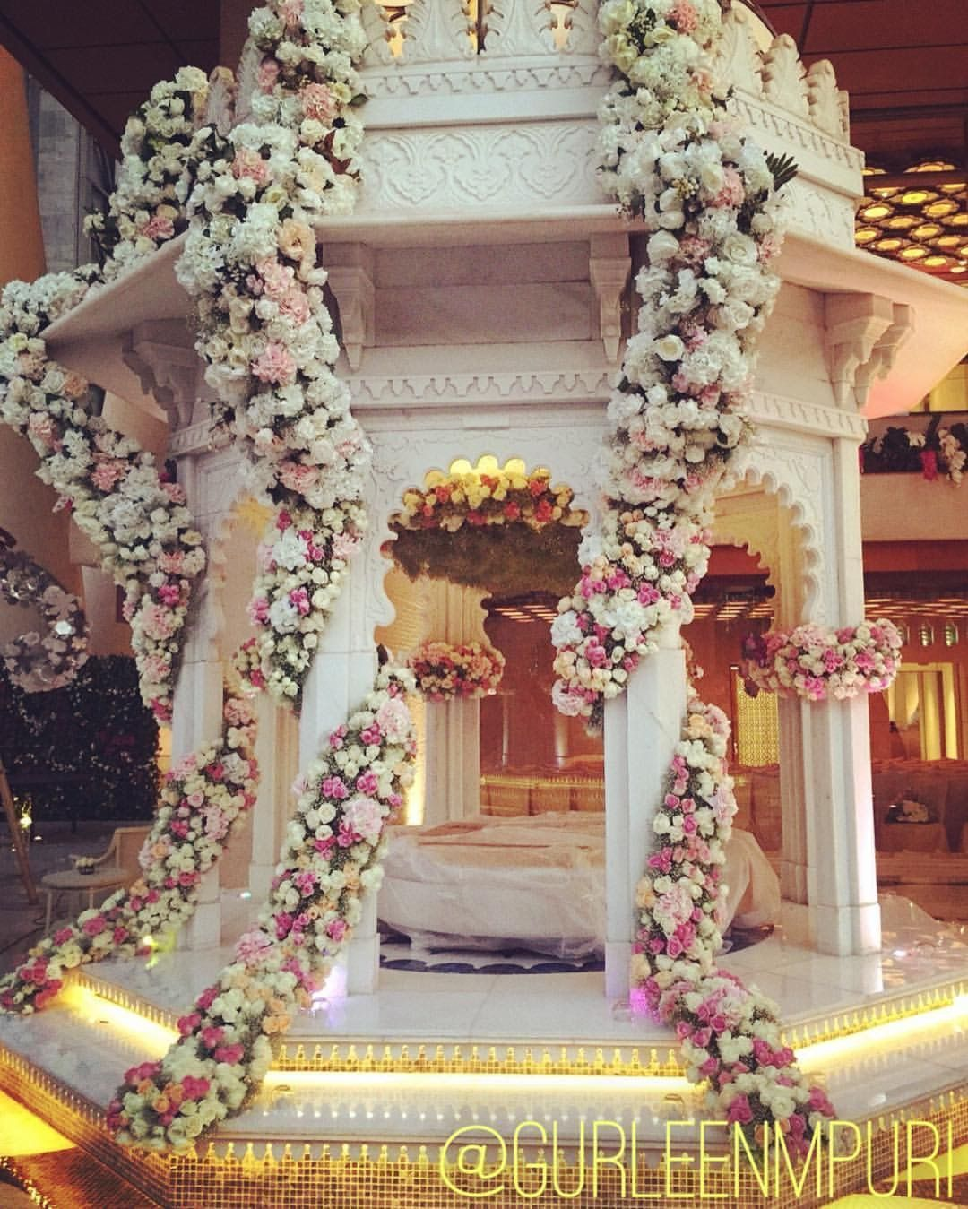 Wedding decor images  A magical mandir accenting with beautiful floral decor Wedding Decor
