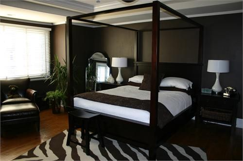 Dark Colored Bedrooms | Dark Chocolate Walls, Wood Canopy Bed, White Bedding,  Wood Nightstands .