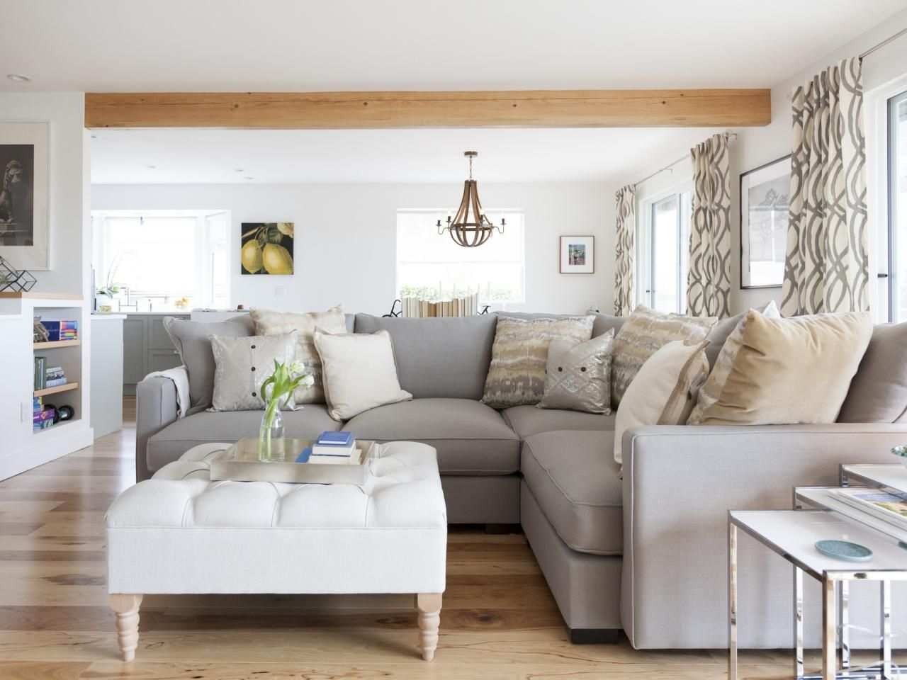 As seen on HGTV's hit show Love It or List It Too, the living room in this space has plenty of seating. With a sectional sofa and ottoman, this small area can easily seat up to ten people.