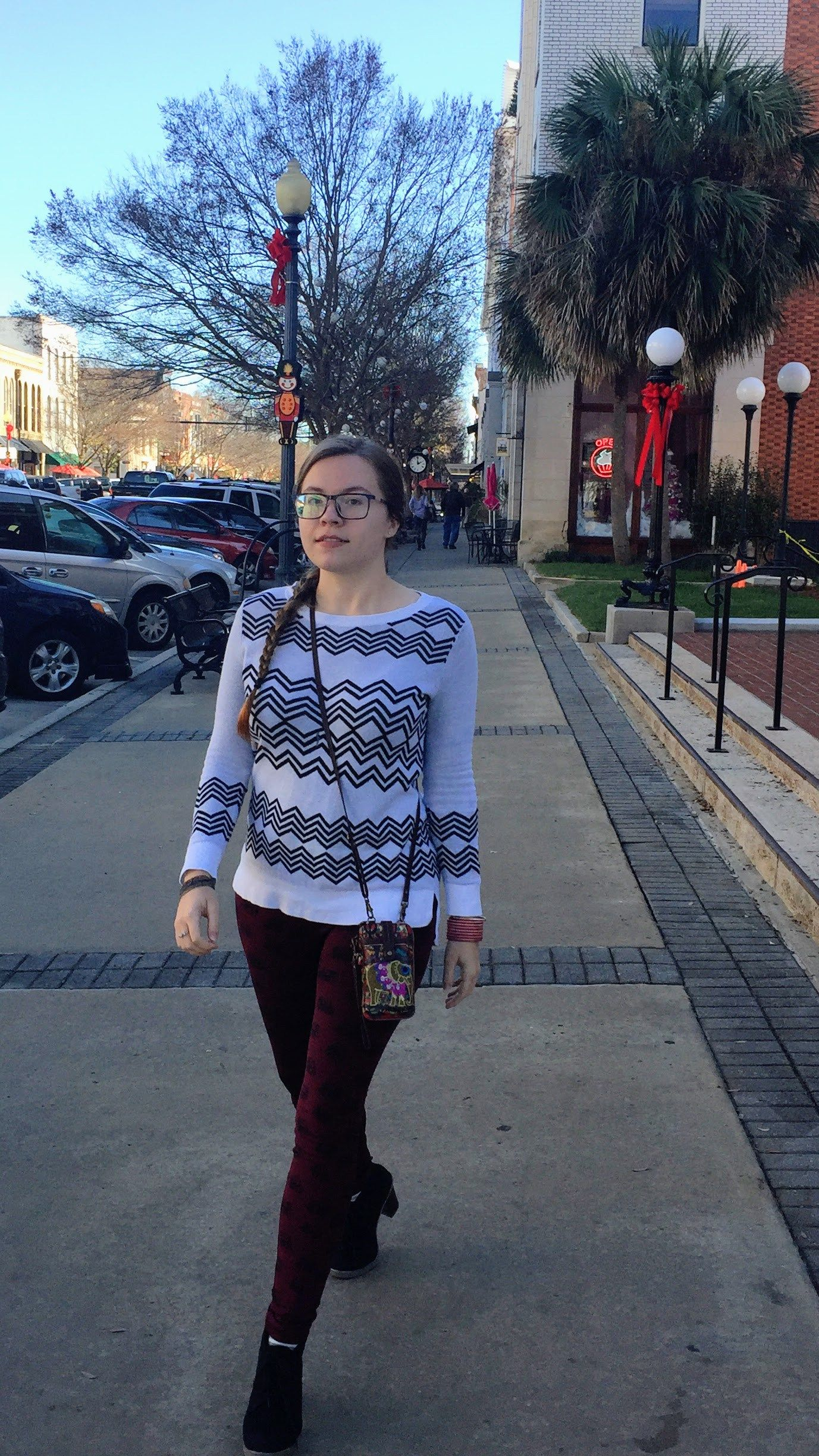 Playing with patterns on Raine In The City! Black & white zigzag sweater and elephant print burgundy leggings in Downtown Thomasville, Georgia.