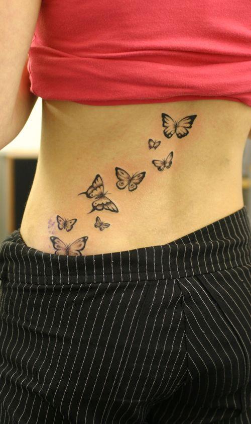 Exemple Tatouage Papillons Qui Volent Femme Bas Du Dos Tattoos