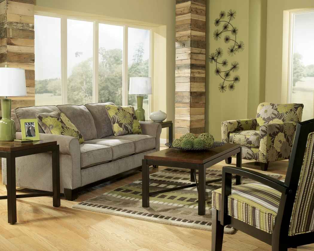 Earth tone living room with green wall paint and gray sofa for Green living room ideas