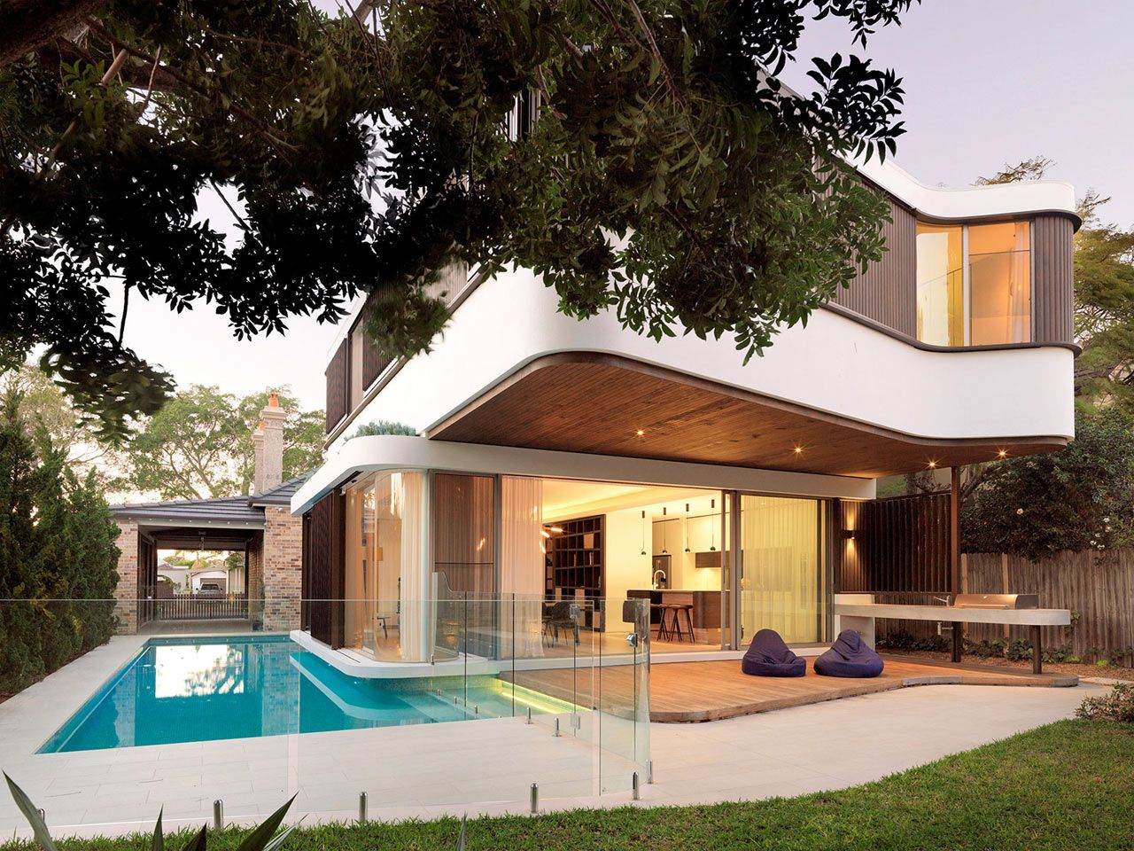 A Modern House With A Wraparound Swimming Pool Modern Pools