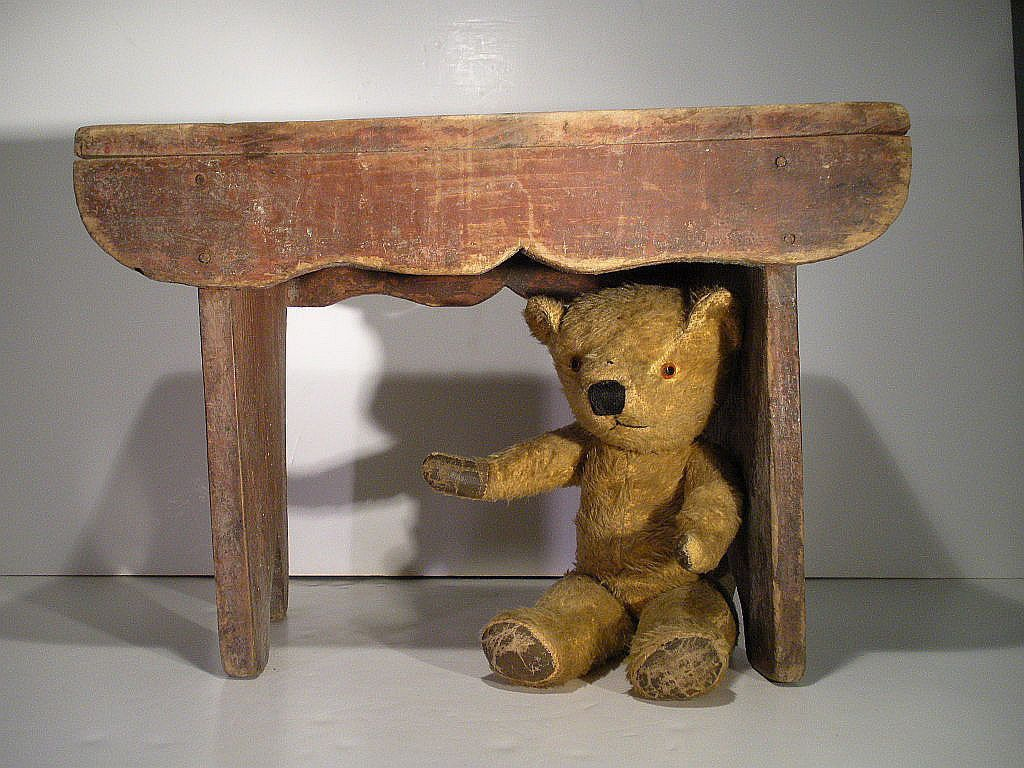 sweet little Ted, hiding under a bench ...♥