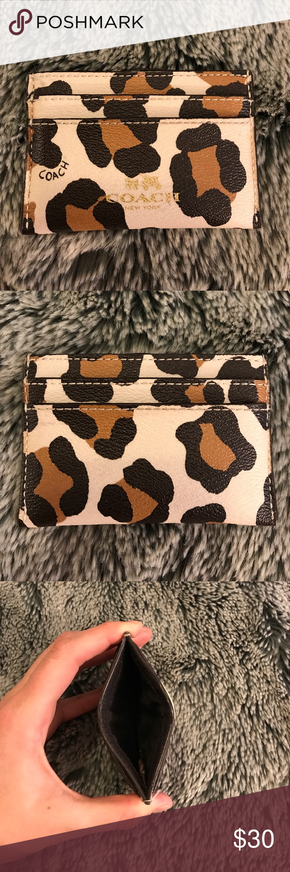 Coach Mini Wallett This wallet has 4 card slots and a larger slot in the middle! It's super small and perfect for a minimalist who loves a statement piece! It's in great condition and ready for a new home! Make an offer! Coach Bags Wallets