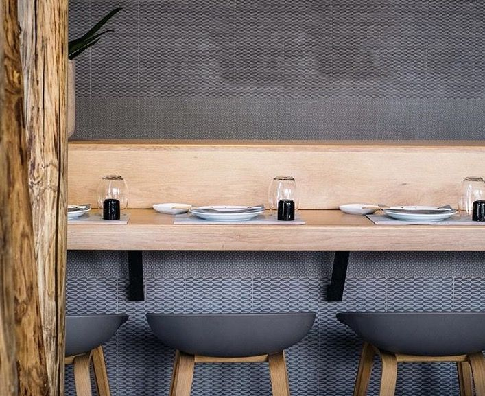 gaku izakaya / sushi minimal interior, mutina tiles, hay stools