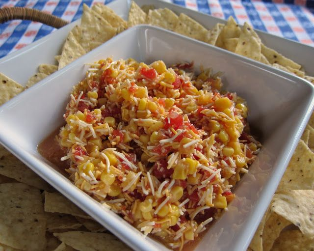 Italian Corn Salsa 1 (11oz) can corn, drained 1 tomato, diced 2 cups cheddar cheese, shredded 1 (4oz) can black olives (optional) 1 cup Italian dressing  Combine all ingredients in medium bowl. Refrigerate 2 hours up to overnight. Serve with tortilla chips or Fritos.