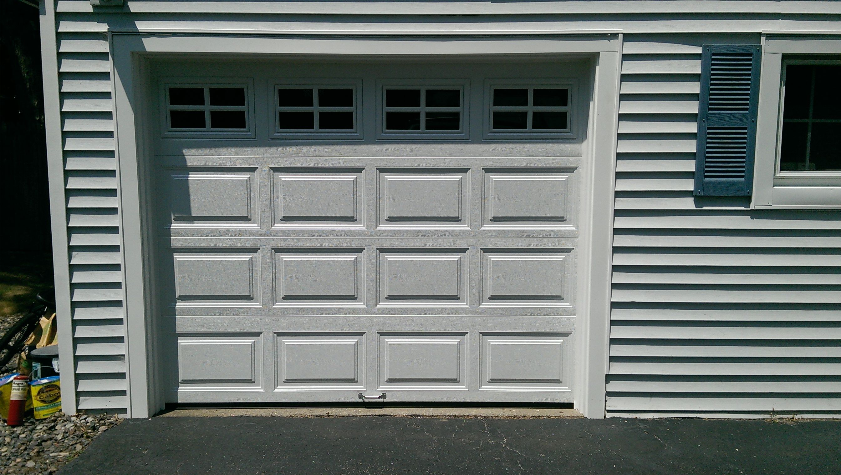Clopaydoors Model 4050 Raised Panel Steel Insulated Garage Door In White With Colonial Glass Install Garage Doors Residential Garage Doors Garage Door Styles