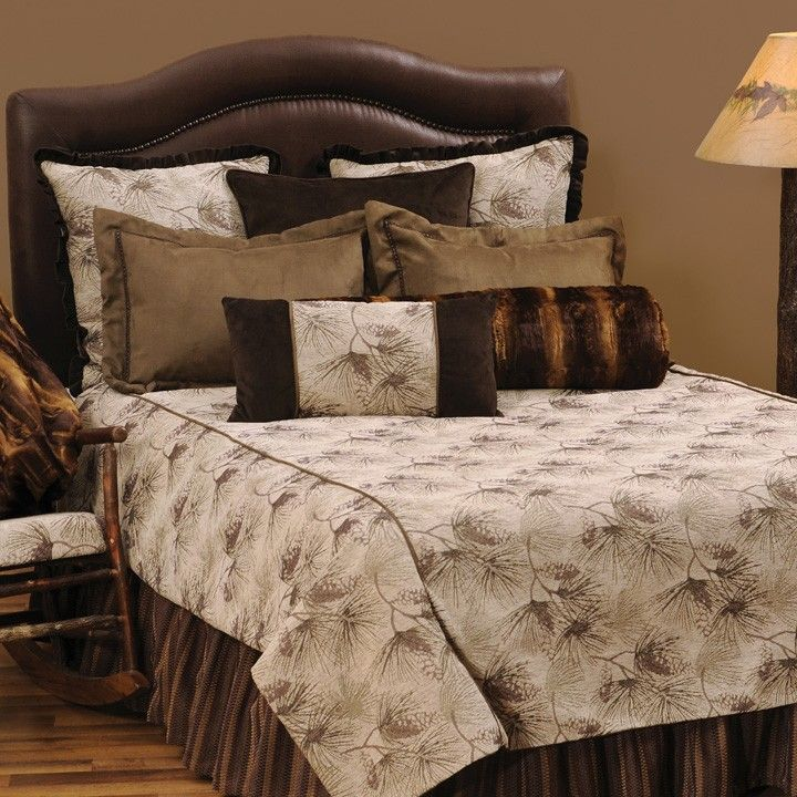 the pine forest cabin bedding has a simple pine cone and branch pattern enhanced with dark