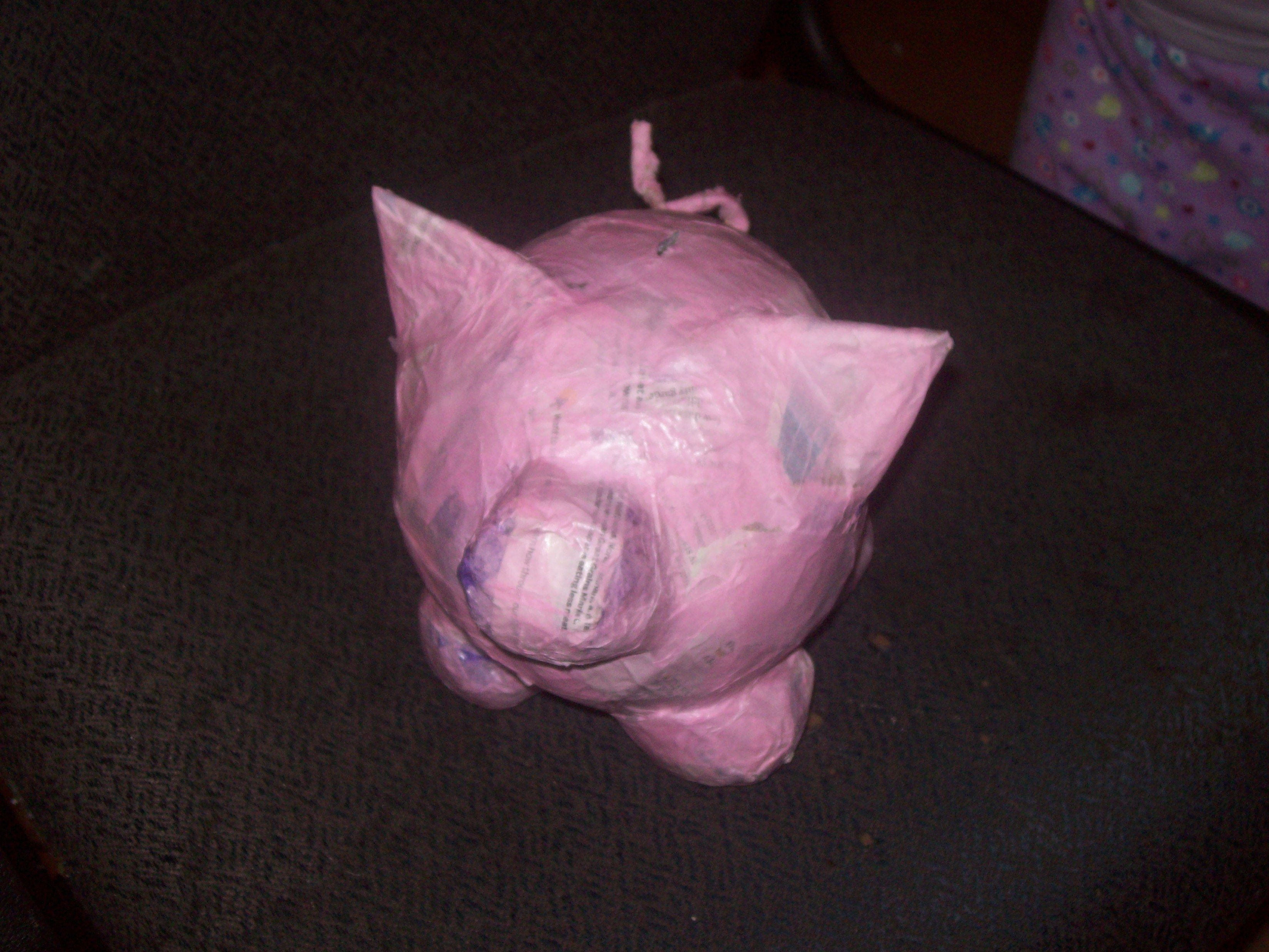 paper mache Piggy Bank   It did get another layer of pink paper and then was decorated by my daughter