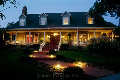 Cape Cod Style House Lit For Evening