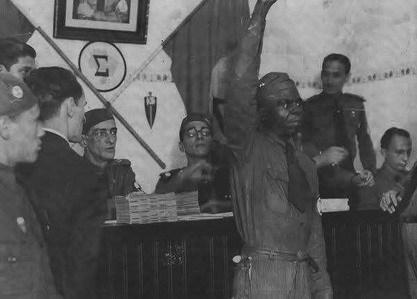 A black Integralist salutes.